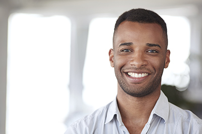 Man smiling after getting his composite filling at Glen Cove Dental Associates