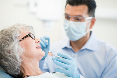 Dentist getting ready to examine patient
